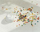 Spilt bowl of cereal on white floor