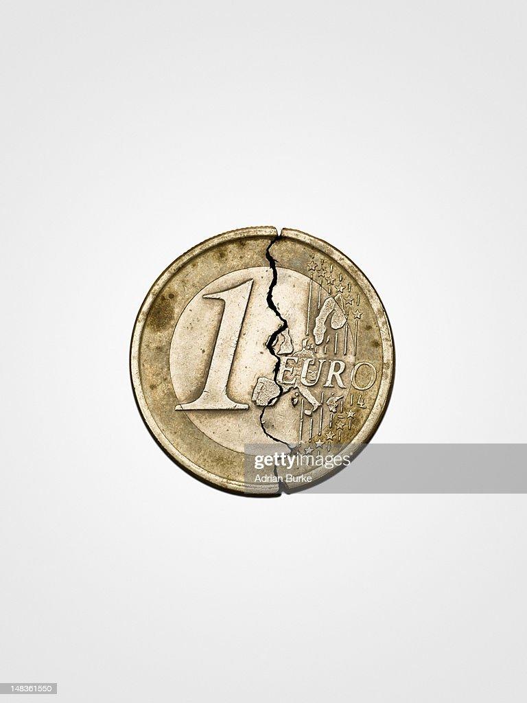 Spilt Euro coin on white background. : Stock Photo
