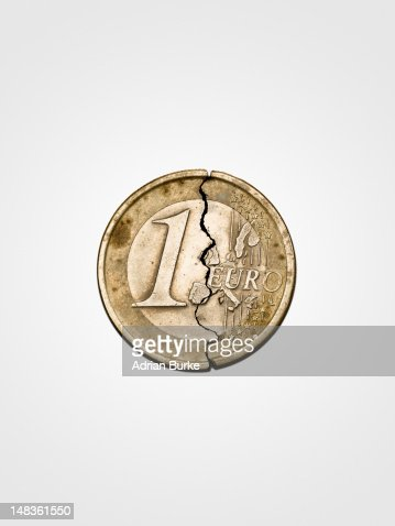 Spilt Euro coin on white background.