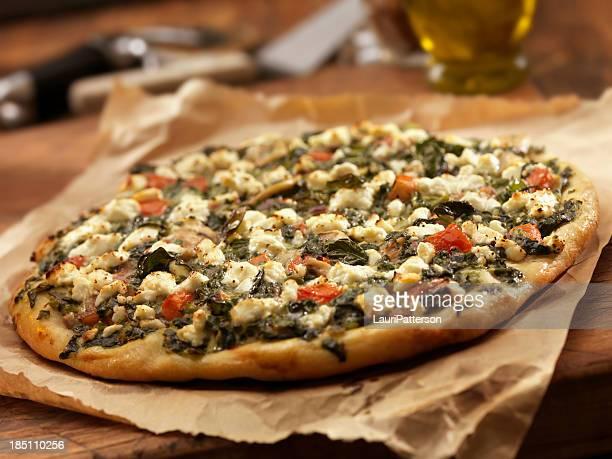 Spinat und Ziegenkäse Pizza