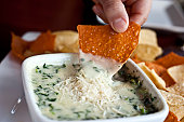 Spinach and parmesan cheese dip with tortilla chips