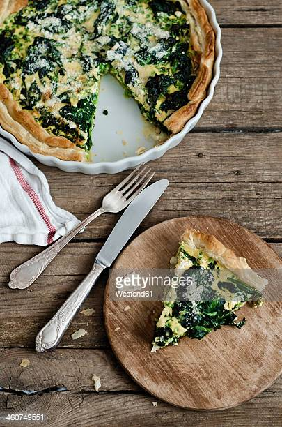Spinach and pea quiche on wooden table
