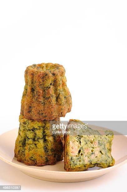 Spinach and salmon canneles or caneles