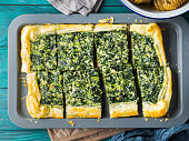 Spinach savory quiche with cream cheese on baking tray