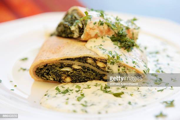 spinach strudel with herbal sauce