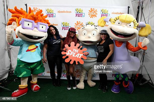 Spinderella Pepa and Salt pose with Rugrats at the Nickelodeon sponsored 90sFEST Pop Culture and Music Festival on September 12 2015 in Brooklyn New...