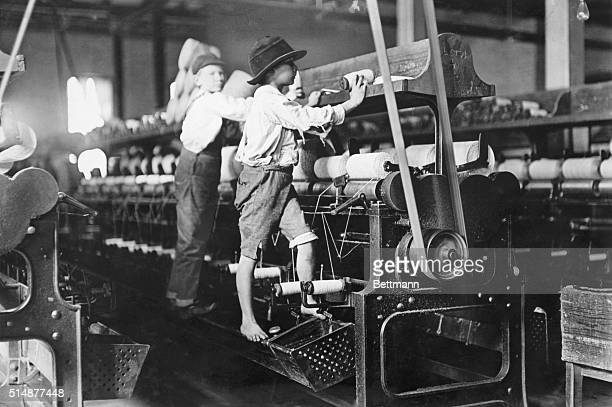 Spindle boys in Georgia cotton mill Photo by Lewis Hine Undated