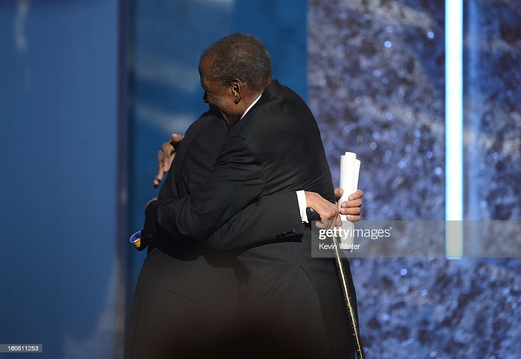 Spingarn Medal honoree Harry Belafonte (L) embraces actor Sidney Poitier onstage during the 44th NAACP Image Awards at The Shrine Auditorium on February 1, 2013 in Los Angeles, California.