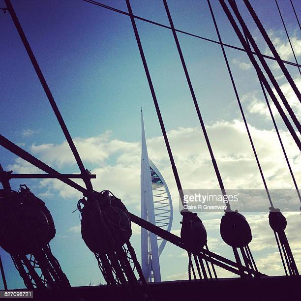 Spinnaker Tower is viewed through silhouetted rigging of HMS Victory in Portsmouth Historic Dockyard Portsmouth England UK