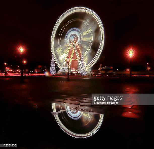 Spinning fair wheel at night