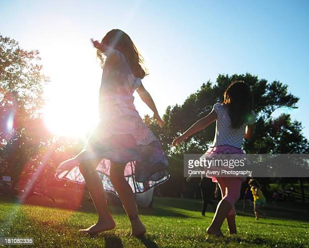 Spinning girls at a park