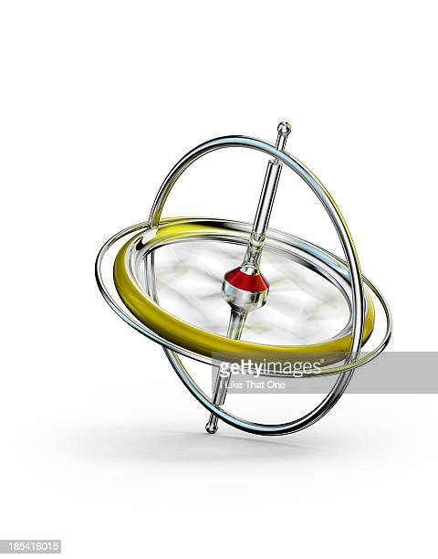 Spinning gyroscope, on a white surface