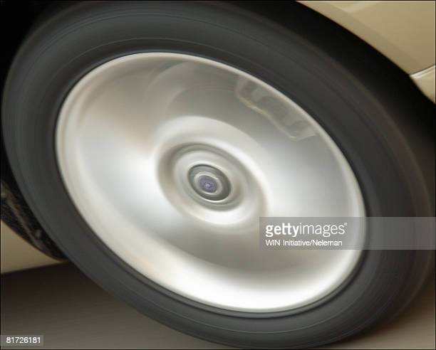 Spinning hubcap of a car, close-up