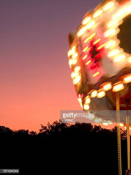 Spinning Marry-Go-Round At Sunset – Vertical