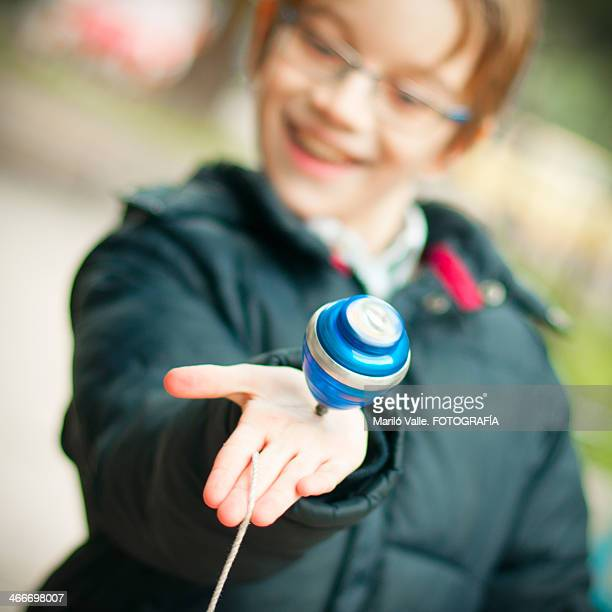 spinning top in child's hand
