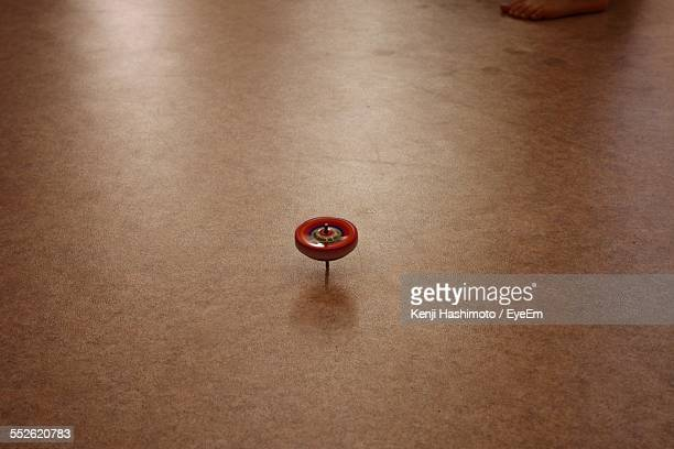 Spinning Top On Floor