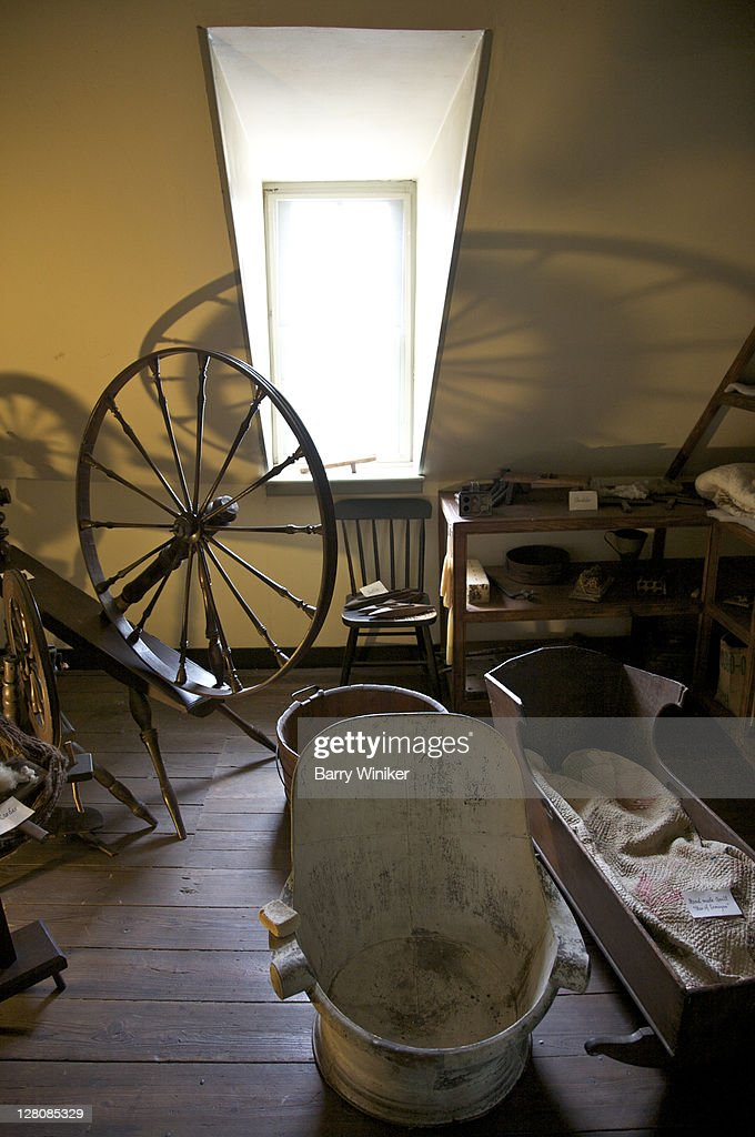 Spinning wheel and cradle upstairs at Rising Sun Tavern, residence built 1760 by Charles Washington, youngest brother of George Washington, Fredericksburg, Virginia, U.S.A. : Stock Photo