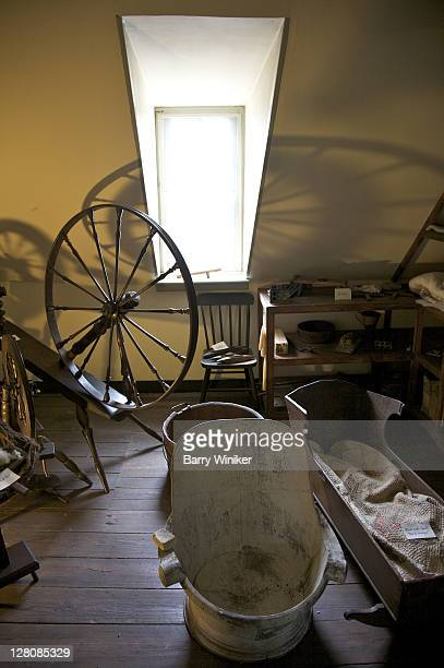 Spinning wheel and cradle upstairs at Rising Sun Tavern, residence built 1760 by Charles Washington, youngest brother of George Washington, Fredericksburg, Virginia, U.S.A.