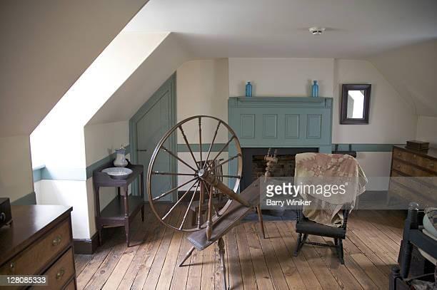 Spinning wheel in upstairs room at Hugh Mercer Apothecary, Fredericksburg, Virginia, U.S.A.