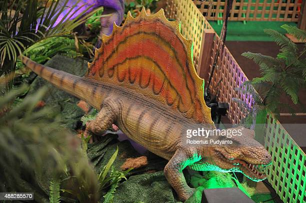 Spinosaurus replica is displayed in the Dinosaur Adventure and Learning Experience Park at Tunjungan Plaza on September 15 2015 in Surabaya Indonesia...