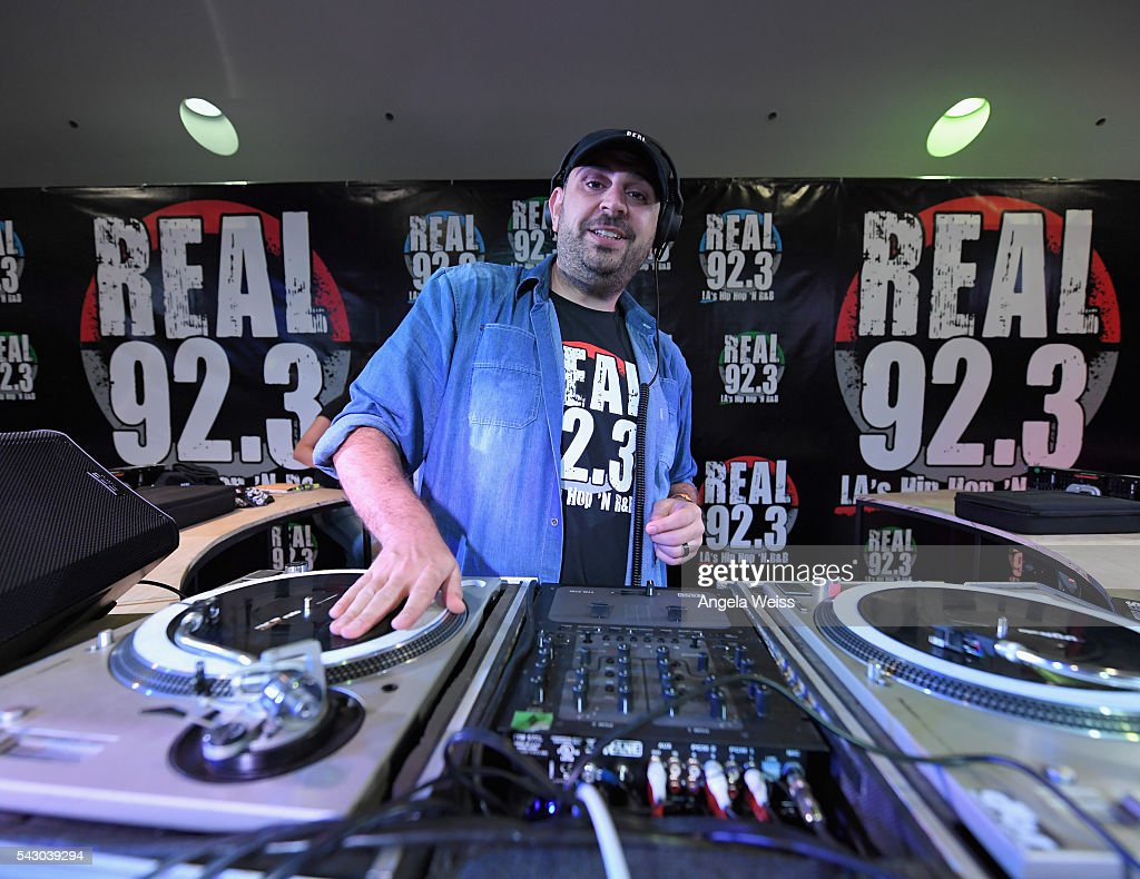 A DJ spins at the Real 92.3 FM booth, part of FAN FEST during the 2016 BET Experience on June 25, 2016 in Los Angeles, California.