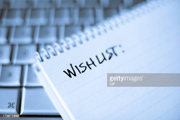 Spiral notebook on Laptop with blank Wishlist