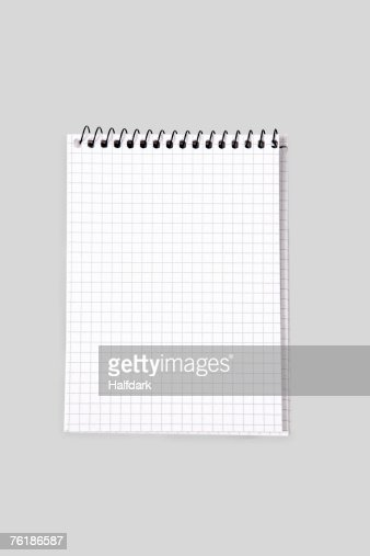 A spiral notebook with grid paper
