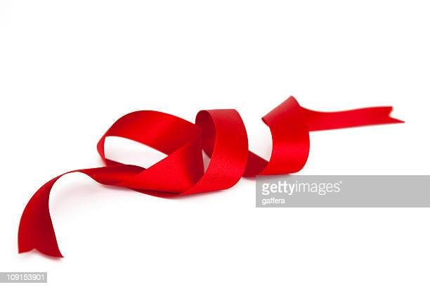 A spiral satin red ribbon with ends cut