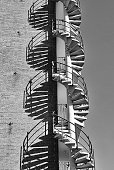 Spiral Staircase Outside Against Wall