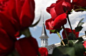 A spire stands beyond a bouquet of roses in advance of the Kentucky Derby at Churchill Downs in Louisville Kentucky US on Saturday May 3 2008 A full...