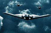 Spirit bomber center flies with two F117A Nighthawks July 19 2000 above dramatic clouds The B2 Spirit is a multirole bomber capable of delivering...