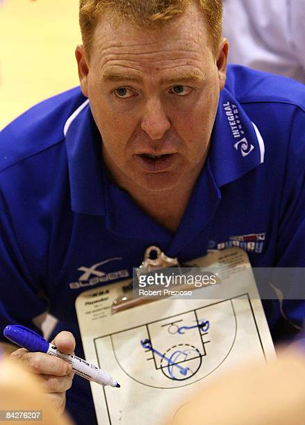 Spirit Coach Rob Beveridge talks tactics to his players during the round 18 NBL match between the Melbourne Tigers and the Sydney Spirit at the State...