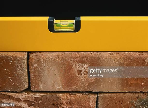 Spirit level on bricks