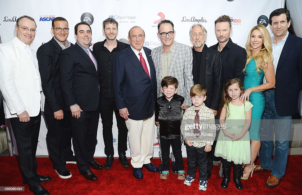 Spirit Music Group Chairman David Renzer, music executive <a gi-track='captionPersonalityLinkClicked' href=/galleries/search?phrase=Doug+Davis&family=editorial&specificpeople=211598 ng-click='$event.stopPropagation()'>Doug Davis</a>, Universal Music Publishing Group North America President Evan Lamberg, songwriter Dr. Luke, producer <a gi-track='captionPersonalityLinkClicked' href=/galleries/search?phrase=Clive+Davis&family=editorial&specificpeople=209314 ng-click='$event.stopPropagation()'>Clive Davis</a>, Virgin Records CCO/EVP <a gi-track='captionPersonalityLinkClicked' href=/galleries/search?phrase=Ron+Fair&family=editorial&specificpeople=2560024 ng-click='$event.stopPropagation()'>Ron Fair</a>, President of the National Academy of Recording Arts and Sciences <a gi-track='captionPersonalityLinkClicked' href=/galleries/search?phrase=Neil+Portnow&family=editorial&specificpeople=208909 ng-click='$event.stopPropagation()'>Neil Portnow</a>, composer <a gi-track='captionPersonalityLinkClicked' href=/galleries/search?phrase=Brian+Tyler&family=editorial&specificpeople=593869 ng-click='$event.stopPropagation()'>Brian Tyler</a>, Stefanie Ridel, and Universal Music Publishing Group Chairman/CEO Zach Horowitz arrive at City of Hope's 10th Anniversary 'Songs Of Hope' on June 4, 2014 in Brentwood, California.