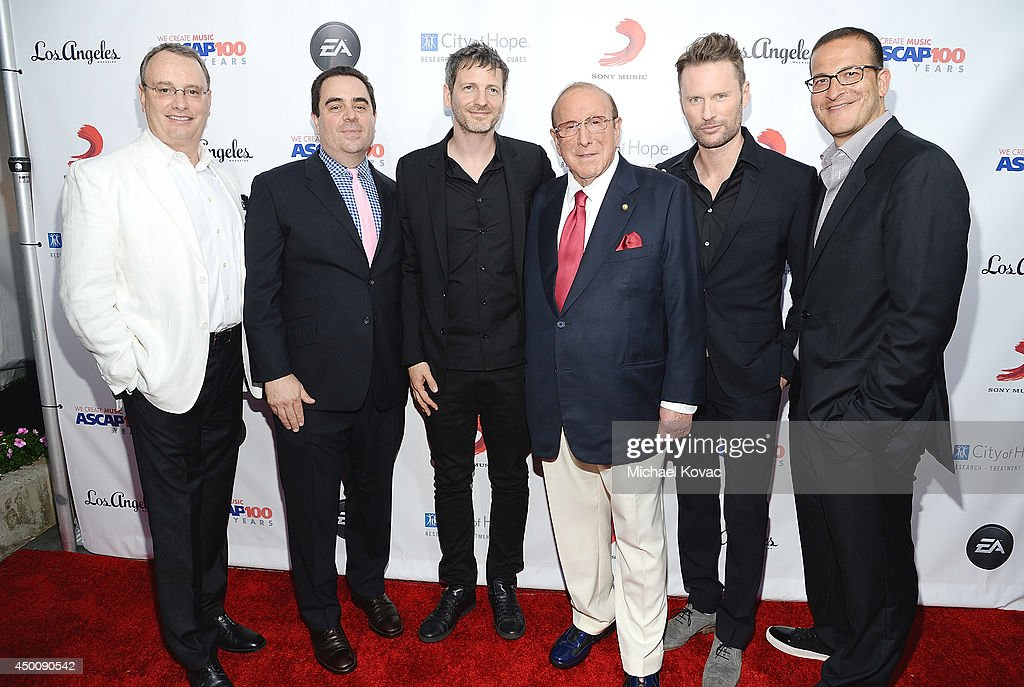 Spirit Music Group Chairman David Renzer, Universal Music Publishing Group North America President Evan Lamberg, songwriter Dr. Luke, producer <a gi-track='captionPersonalityLinkClicked' href=/galleries/search?phrase=Clive+Davis&family=editorial&specificpeople=209314 ng-click='$event.stopPropagation()'>Clive Davis</a>, composer <a gi-track='captionPersonalityLinkClicked' href=/galleries/search?phrase=Brian+Tyler&family=editorial&specificpeople=593869 ng-click='$event.stopPropagation()'>Brian Tyler</a>, and music executive <a gi-track='captionPersonalityLinkClicked' href=/galleries/search?phrase=Doug+Davis&family=editorial&specificpeople=211598 ng-click='$event.stopPropagation()'>Doug Davis</a> arrive at City of Hope's 10th Anniversary 'Songs Of Hope' on June 4, 2014 in Brentwood, California.