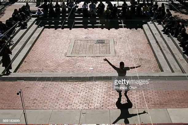 A spirited audience member dances in the University Student Union's Court of Community during a musical performance marking the first day of Black...