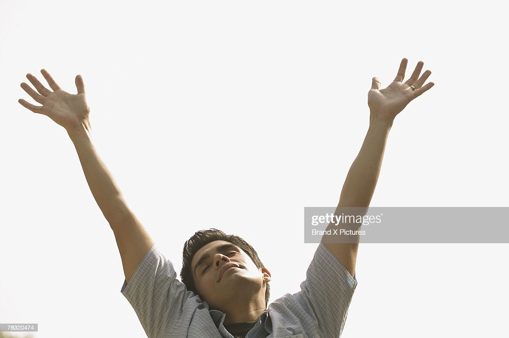 Spiritual man with arms outstretched : Stock Photo