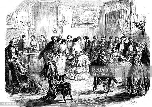 Spiritualist meeting in a Paris drawing room 1853 Communicating with the 'other side' by means of the hat tableturning and the pendulum From...