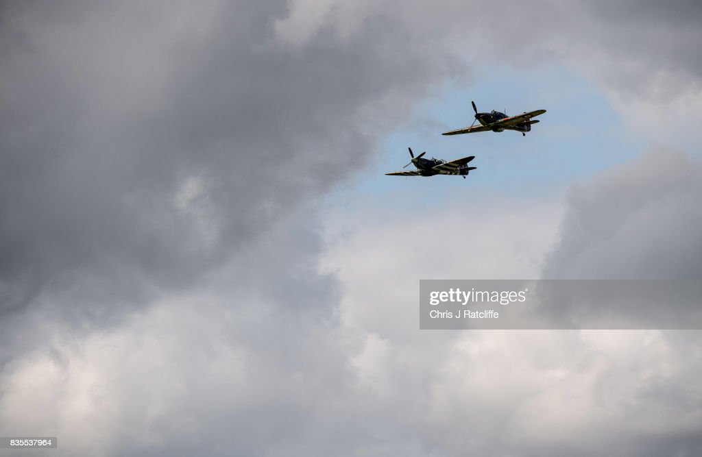 A Spitfire and a Hurricane during a flying display at the Biggin Hill Festival of Flight on August 19, 2017 in Biggin Hill, England. The Biggin Hill Festival of Flight is an annual airshow event and in 2017 the airport is celebrating its centenary. The airport only became exclusively business and general aviation in 1959, prior to which it was used by the British Royal Air Force.