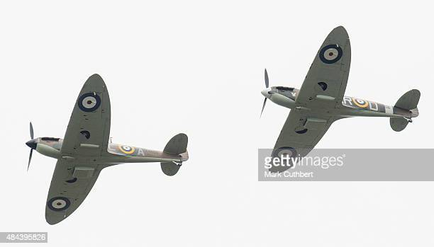 Spitfire and Hurricane planes take part in a Battle of Britain flypast on August 18 2015 in Biggin Hill England A total of 18 Spitfires and six...
