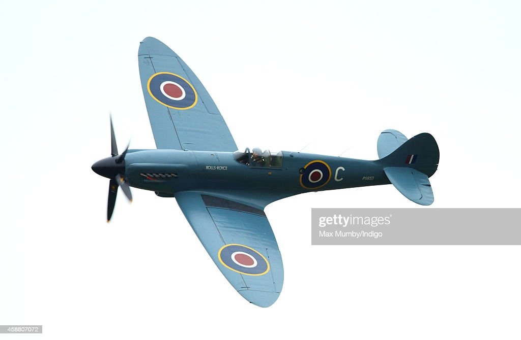 A Spitfire flies over the Armed Forces Memorial after the Armistice Day Service at the National Memorial Arboretum on November 11 2014 in Alrewas...