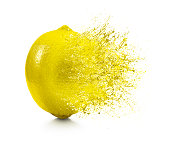 A splash coming off of a lemon on a white background