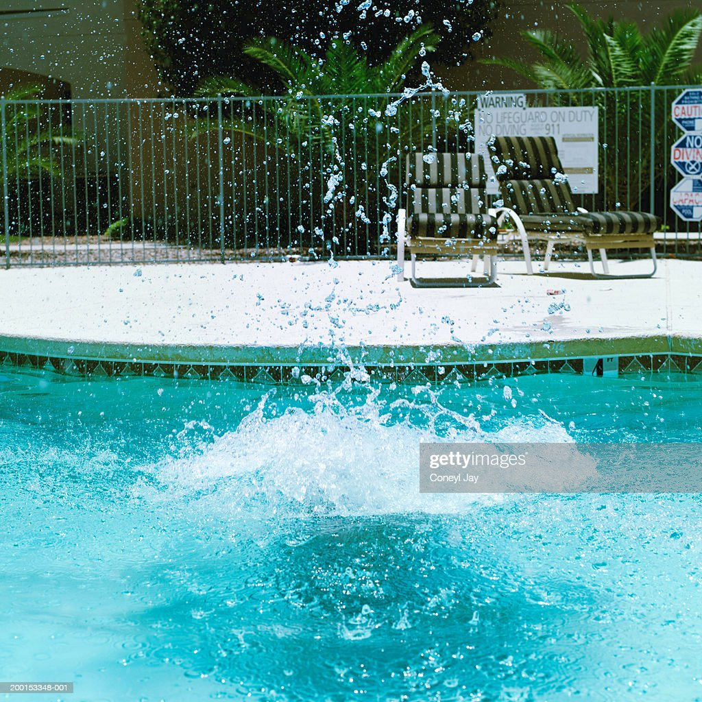 Swimming Pool Identification : Splash in outdoor swimming pool stock photo getty images
