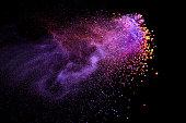 Splash of color powder on black background