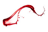 single splash of red wine isolated on white background