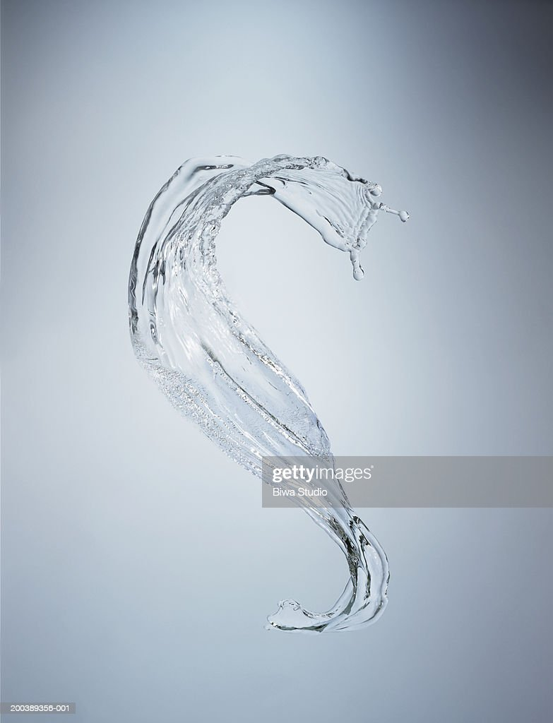 Splash of water in mid-air close-up : Stock Photo