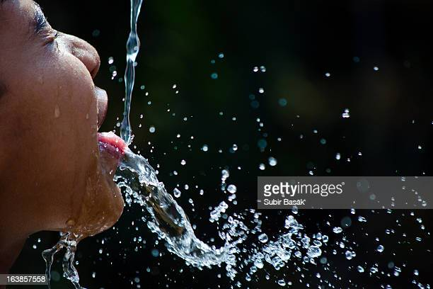 Splash of water on the mouth of a girl child