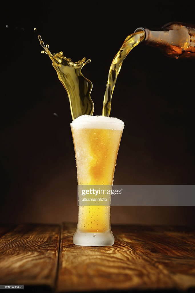 Splashing - Beer pour in glass : Stock Photo