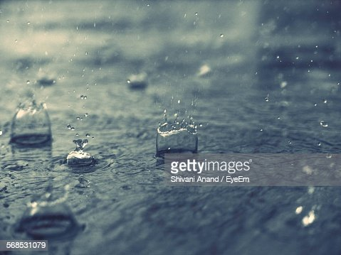 Splashing Water Drops On Road