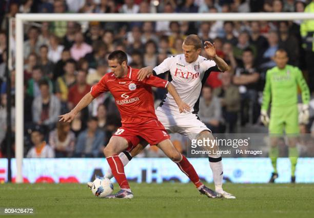 RNK Split's Duje Cop battles for the ball with Fulham's Brede Hangeland